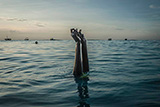 Swim instructor Chema, 17, snaps her fingers as she disappears underwater in Nungwi, Zanzibar, 2017